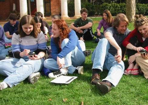 Playing economics games with handheld devices out on the famous UVA lawn with my experimental economics class (that's me on the very far right in the red and my advisor/professor right next to me). This was a big deal since it was WAY before iPads!