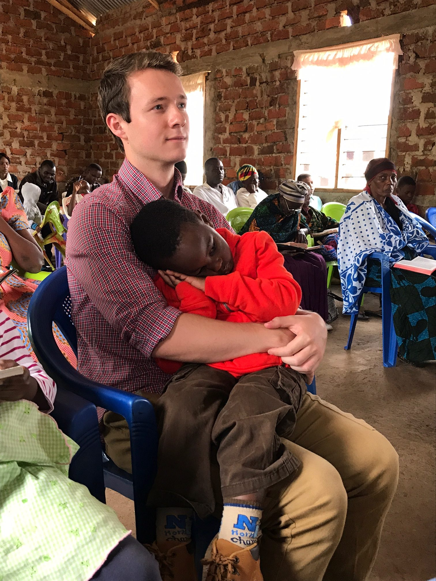 Casey With A Child In Tanzania