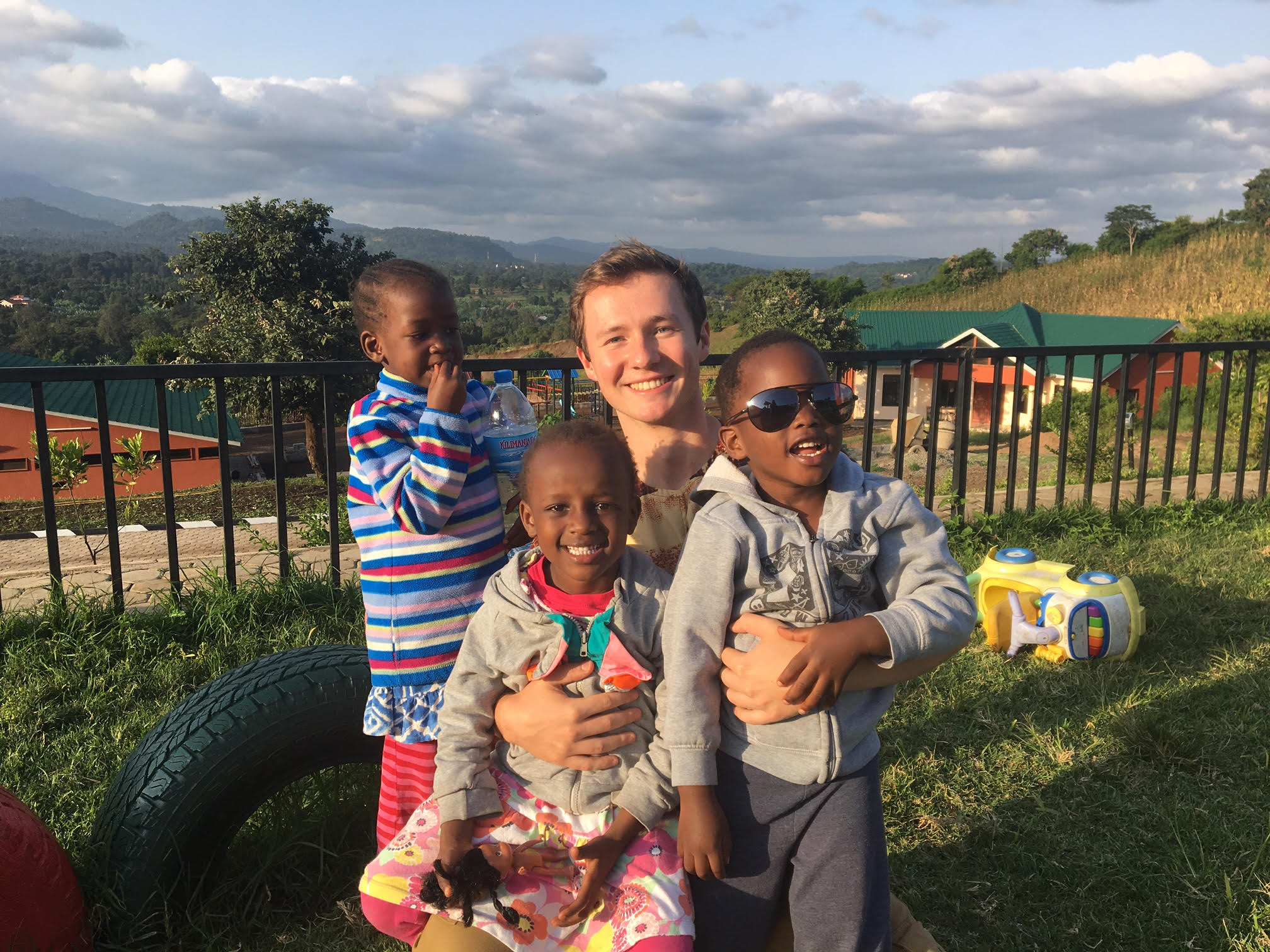 Casey With Children In Neema Village