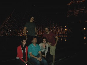 English majors in front of night-time Louvre