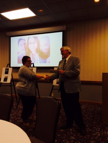 Ashley Bryan accepting recognition from Dr. Pruett