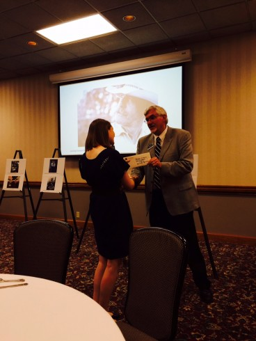 Addie Rich accepting recognition from Dr. Pruett