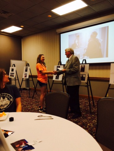 Meagan McBride accepting recognition from Dr. Pruett