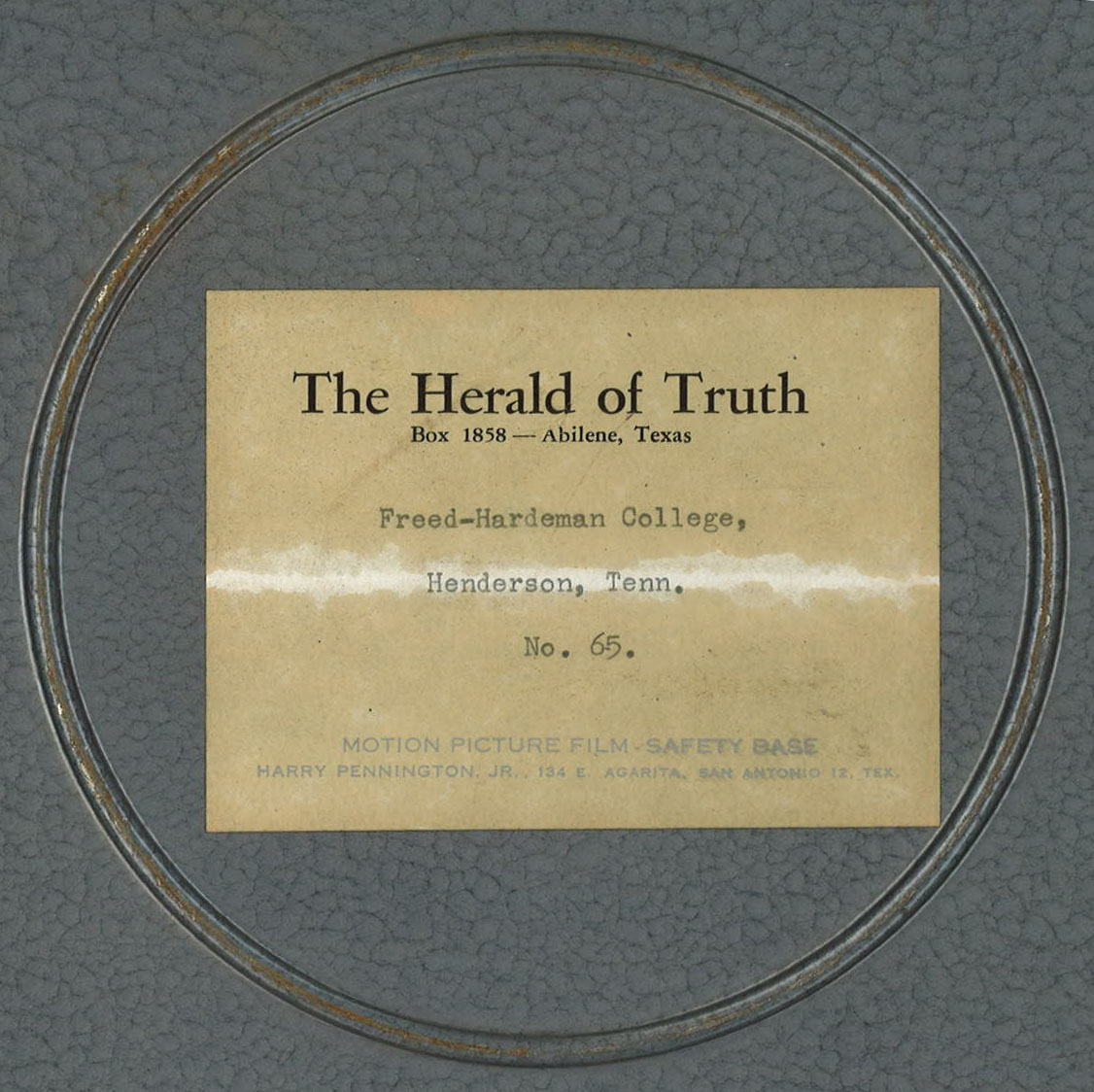 16mm film canister with label, Herald of Truth Television Film #65. Center for Restoration Studies, Milliken Special Collections, Abilene Christian University, Abilene, TX.