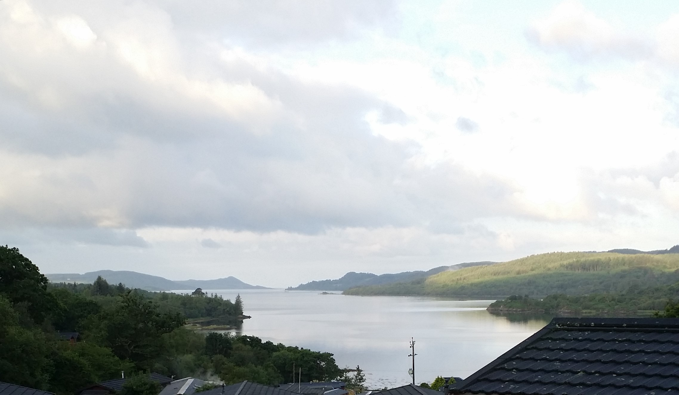 West Loch Tarbert looking southwest between green hills of Kintyre on left and Argyll on right.