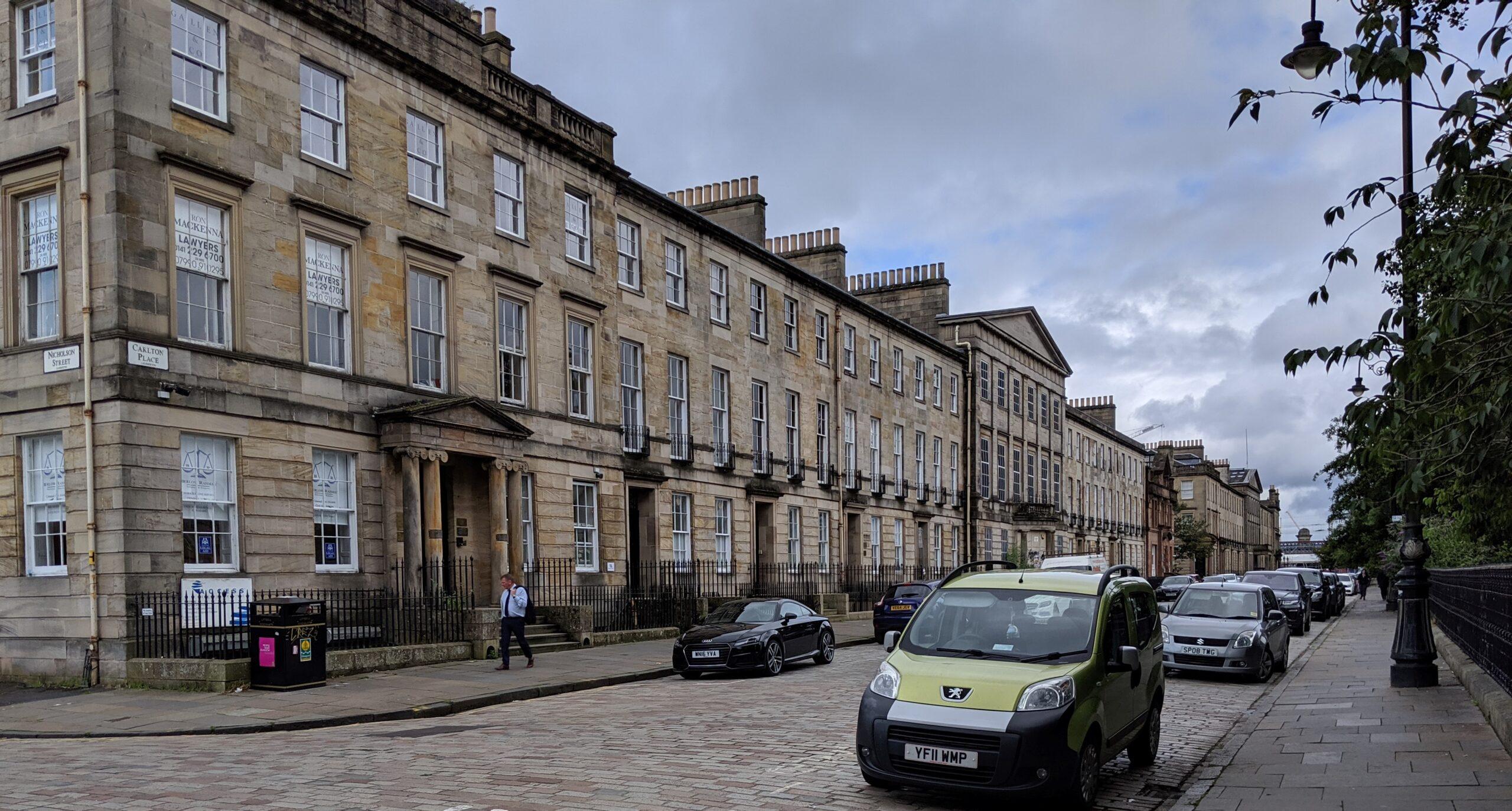 Long row of three-story buildings facing a street
