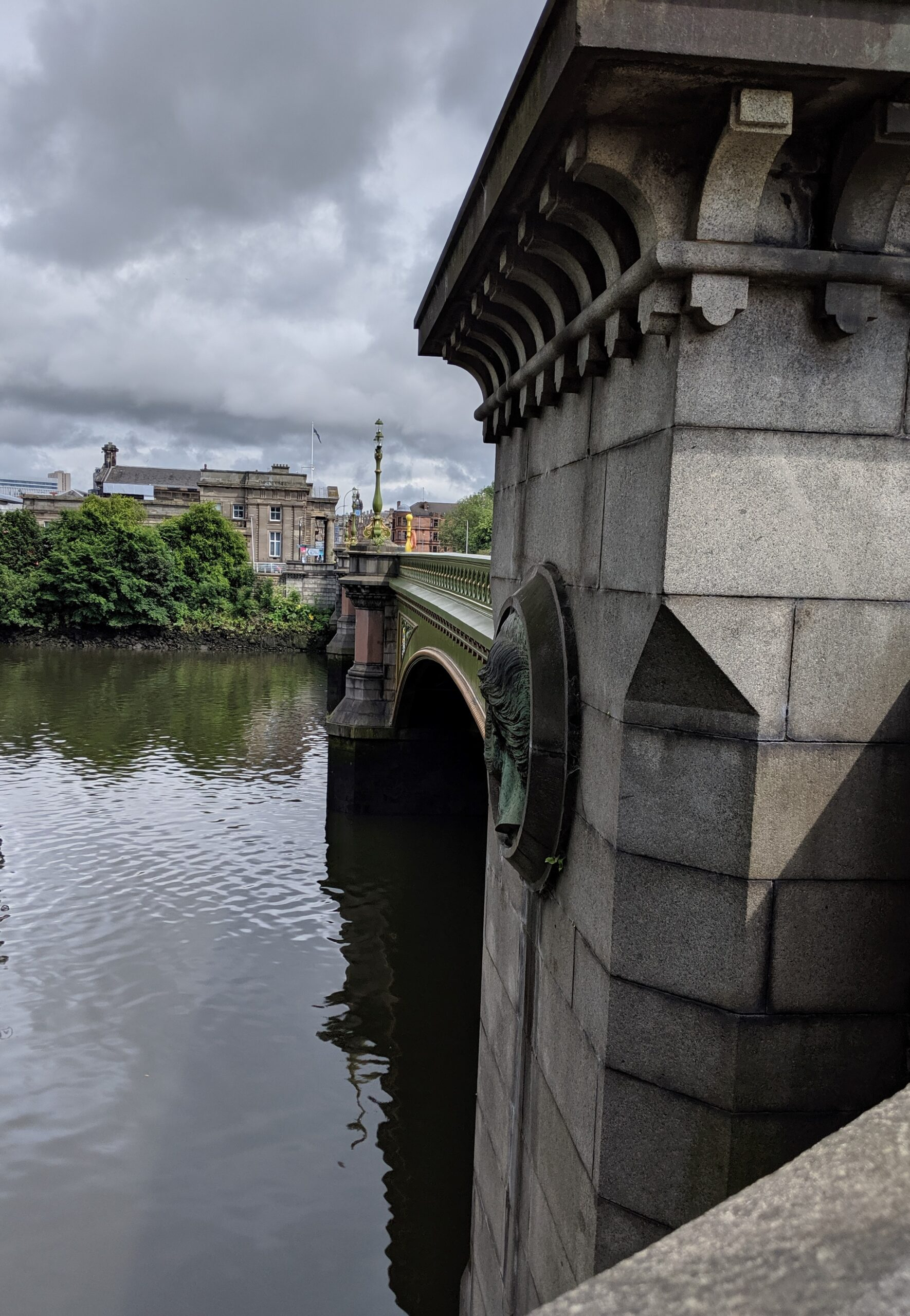 A large stone bridge crosses the Clyde River toward the north bank of the river.