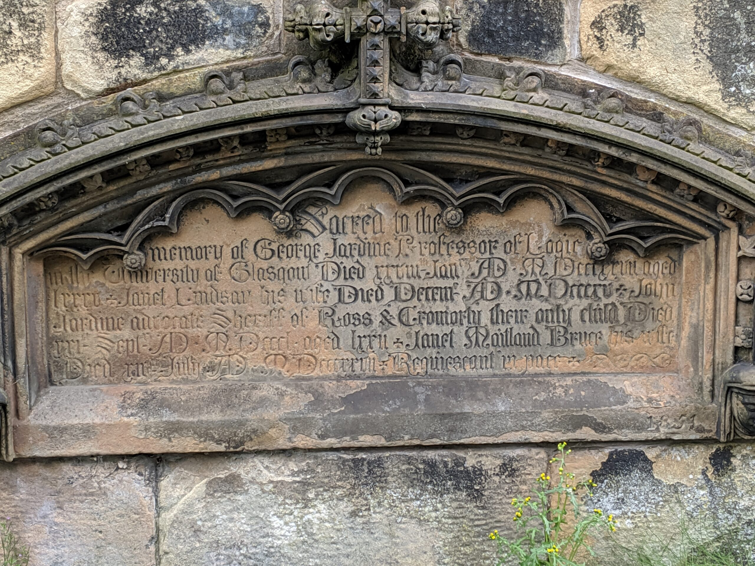 A stone plaque in the stone wall around the church marks the family burial site for George Jardine's family.