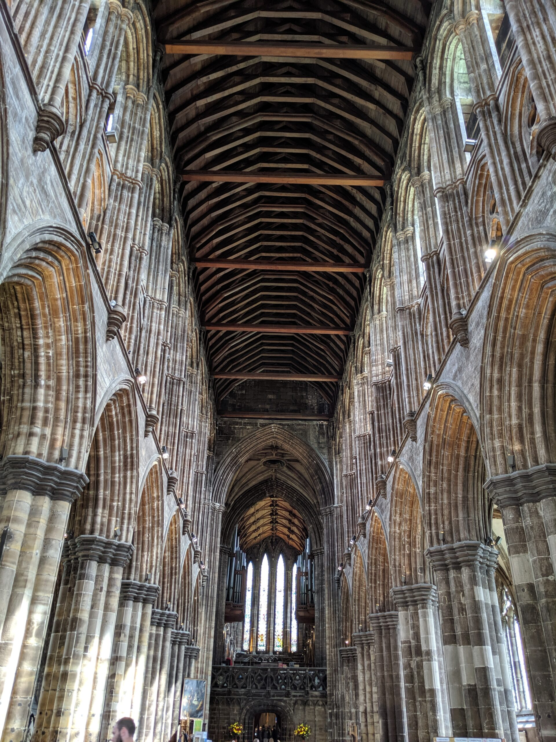 Tall stone arches of the interior of Glasgow Cathedral