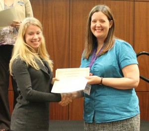 Rebekah receiving the Outstanding Presentation Award from Dr. Sutherlin